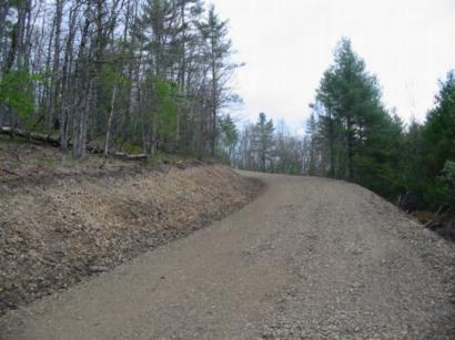Gentle grade on access road will minimize maintaince costs
